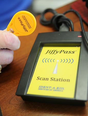 A Jiffy Pass scan station at the entrance of Monroe Elementary School allows teachers, staff, regular substitute teachers and volunteers to quickly sign in with their key fob. (Staff Photo by BONNIE VCULEK)