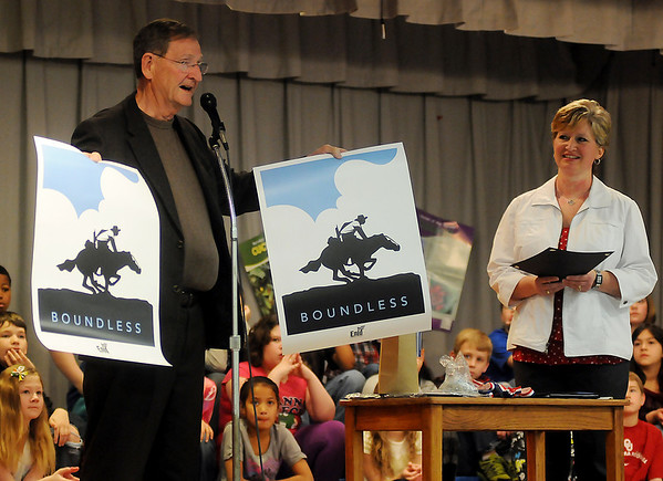 """Enid Mayor Bill Shewey (left) proclaims Thursday, Feb. 14, 2013, as Hayes Elementary Hawks' Day and presents Hayes Elementary School principal Jane Johnson (right) with new Enid """"Boundless"""" brand posters during the Healthier US Silver School assembly for teachers, students and parents. Hayes Elementary School, in Enid, was the only school in Oklahoma to receive the prestigious award. (Staff Photo by BONNIE VCULEK)"""