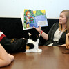 Children and Casey, a Calico feline listen as Chelsey Speakman, a behavioral health and rehabilitation specialist, reads a book at Choices Institute Friday, Feb. 15, 2013. (Staff Photo by BONNIE VCULEK)