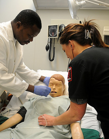 NWOSU students (from left) Titus Bakare and Frannie Landrigan perfect their nursing skills at the Emma Lee Tucker Ketterman Clinical Simulation Lab at the Enid campus Thursday, Feb. 7, 2013. (Staff Photo by BONNIE VCULEK)