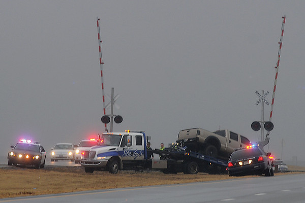 Oklahoma Highway Patrol, Troop J, Garfield County Sheriff Department, Enid Police Department, Enid Fire Department and Life EMS work a truck-train crash between 78th and 90th Street on East 412 Thursday, Feb. 7, 2013. (Staff Photo by BONNIE VCULEK)