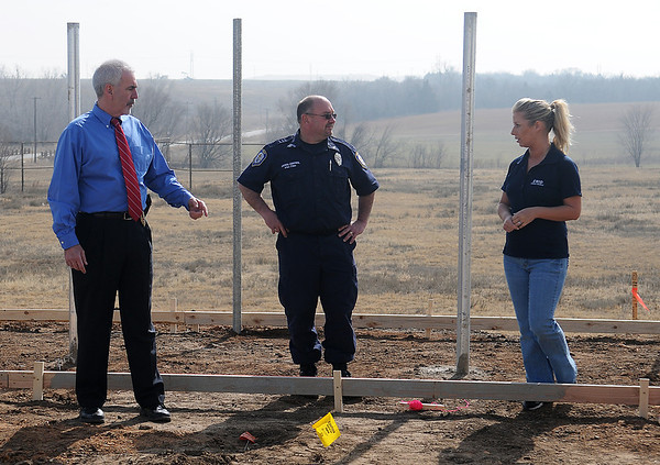 Enid Police Chief Brian O'Rourke (left), Enid Animal Control Supervisor Allen Elder, and volunteer Rachel Hancock inspect the work on the new outside run and pen area Thursday, Feb. 8, 2013. Weather permitting, the concrete will be poured next Wednesday. (Staff Photo by BONNIE VCULEK)
