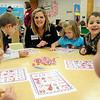 Carli Aebi plays Valentine's Day Bingo with Hayes Elementary School kindergarten students Thursday, Feb. 14, 2013. The school's PTA provides games and educational activities instead of non-healthy treats for students and staff. Hayes Elementary was recently honored as Oklahoma's only Healthier US School Silver Award winner. (Staff Photo by BONNIE VCULEK)