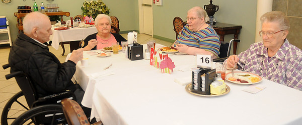 Harley Maddox, Melba Best, Karen Stockwell and Evelyn Radcliff (from left, clockwise) enjoy a noon meal together at Greenbrier Village. Clients may order from the regular menu or select the special of the day as long as their choices follow their recommended dietary needs. (Staff Photo by BONNIE VCULEK)