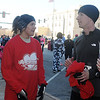 Amy Banks (left), Junior Welfare League Warm Your Heart 5K overall women's winner, visits with other racers Saturday, Feb. 2, 2013, in downtown Enid. Banks, who is stationed at Vance Air Force Base, finished with a time of 21:08. (Staff Photo by BONNIE VCULEK)