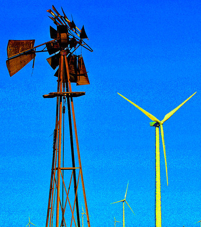 Old and new windmills dot the landscape east of Kremlin. (Staff Photo by BILLY HEFTON)