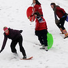 Claire Andrews snowboards down the South Van Buren overpass slope as fellow Enid High School classmates sled Thursday, Feb. 21, 2013. (Staff Photo by BONNIE VCULEK)