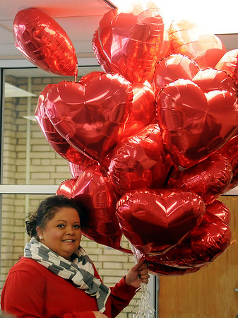 Misti Schmidt arrives with balloons for a fifth-grade homeroom as parents arrive to volunteer for Valentine's Day celebrations at Hayes Elementary School Thursday, Feb. 14, 2013. The school's PTA provides games and educational activities instead of non-healthy treats for students and staff. Hayes Elementary was recently honored as Oklahoma's only Healthier US School Silver Award winner. (Staff Photo by BONNIE VCULEK)