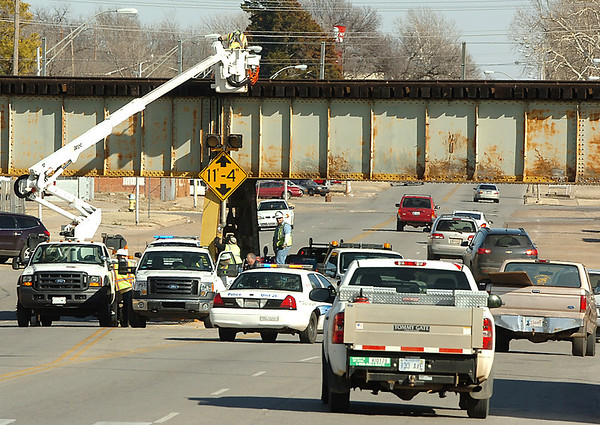 Traffic detours around Enid city crews as they work on the railroad bridge over Maine Street. (Staff Photo by BILLY HEFTON)