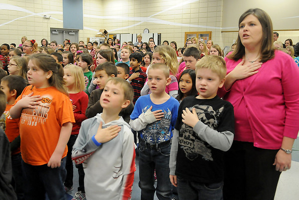 Hayes Hawks and their teachers say the Pledge of Allegiance during the Healthier US Silver School assembly at Hayes Elementary School Thursday, Feb. 14, 2013. The Enid school was the only Oklahoma school to receive the prestigious award. (Staff Photo by BONNIE VCULEK)