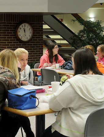 Students at Northwestern Oklahoma State University Enid enjoy a lunch break during the annual Chocolate Day in the Commons area Tuesday, Feb. 19, 2013. (Staff Photo by BONNIE VCULEK)