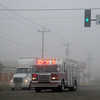 A semi-truck driver pulls over to the right side of S. Van Buren and Southgate Road as Enid Fire Department's Rescue 1 responds to an emergency Wednesday, Feb. 6, 2013. Heavy fog limited visibility of area drivers. (Staff Photo by BONNIE VCULEK)