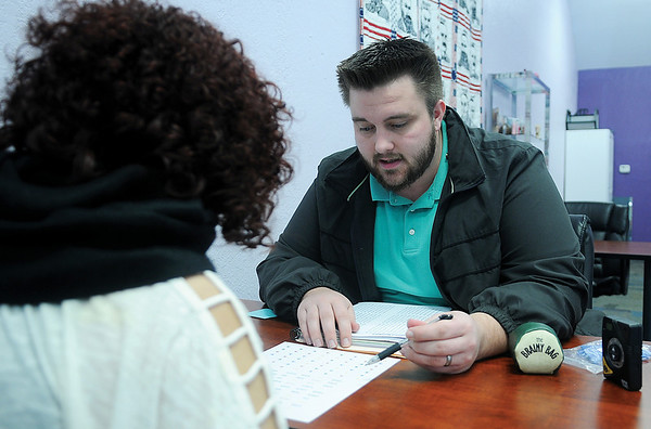Taylor Howard, with LearningRx, works with a client at the new business location at 2106 W. Willow Friday, Feb. 8, 2013. (Staff Photo by BONNIE VCULEK)