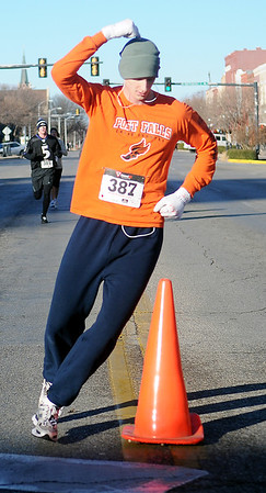 Seth Hyde leads the race by more than one-half block as he takes an extra spin around the turn-around cone on Randolph during the  Junior Welfare League Warm Your Heart 5K Rund and one mile fun run Saturday, Feb. 2, 2013. Hyde, who is stationed at Vance Air Force Base, was the men's overall winner with a 20:01 chip time. (Staff Photo by BONNIE VCULEK)