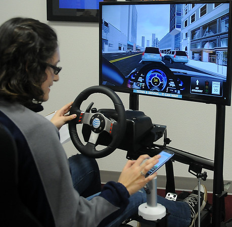 Raquel Estrada sends a text as she drives during an AT&T Virtual Reality simulation at Autry Technology Center Tuesday, Feb. 19, 2013. AT&T and Autry Technology Center provided the event for nearly 200 students and staff, who pledged to not text and drive. (Staff Photo by BONNIE VCULEK)