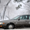 Large snowflakes fall as a driver cautiously travels south on U.S. 81 during a winter storm Wednesday, Feb. 20, 2013. The National Weather service has issued a travelers advisory for Enid and Northwest Oklahoma through Thursday as more snow and sleet are expected.  (Staff Photo by BONNIE VCULEK)