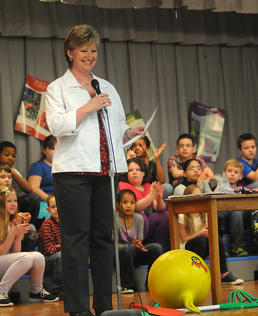 Jane Johnson, Hayes Elementary School principal, greets her students during the Healthier US Silver School assembly Thursday, Feb. 14, 2013. Hayes Elementary School was the only Oklahoma school to receive the prestigious award from the USDA. (Staff Photo by BONNIE VCULEK)