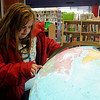 Ally Gentry uses the illuminated globe to find the city where she was born during trip to the Public Library of Enid and Garfield County Friday, Feb. 22, 2013. (Staff Photo by BONNIE VCULEK)