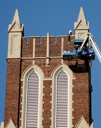 Advanced Masonry employees install the new spire at First Presbyterian Church Saturday, Feb. 16, 2013. (Staff Photo by BONNIE VCULEK)