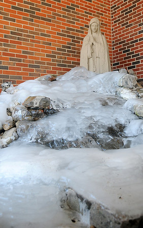 Layers of ice form on a water feature outside St. Mary's Regional Medical Center Tuesday, Feb. 11, 2014. (Staff Photo by BONNIE VCULEK)