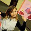 Cassidy Turnbow smiles as she holds the Victorian valentines she made during craft day at the Cherokee Strip Regional Heritage Center Saturday, Feb. 8, 2014. (Staff Photo by BONNIE VCULEK)