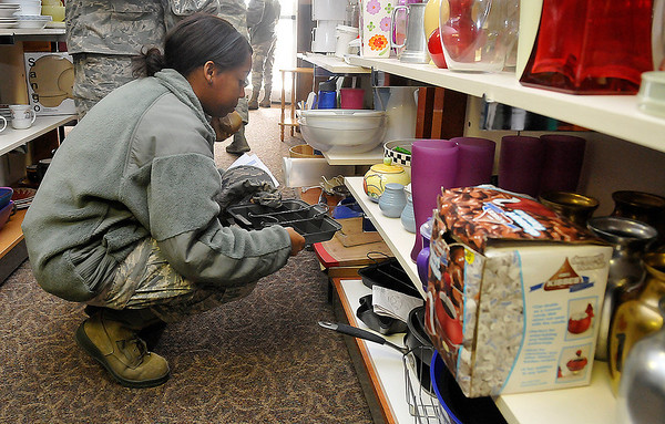 Senior Airman Michelle Anthony looks at items at the Airman's Attic at Vance Air Force Base. (Staff Photo by BILLY HEFTON)