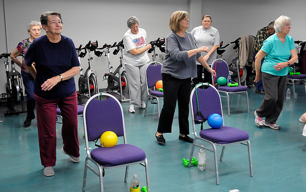 Members of the Silver Sneakers work out during a senior fitness class at the Denny Price Family YMCA. (Staff Photo by BILLY HEFTON)