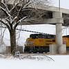 Snow covers the landscape as a Union Pacific Train passes under the S. Van Buren overpass Tuesday, Feb. 4, 2014. (Staff Photo by BONNIE VCULEK)
