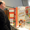 Todd Gungoll glances at the 2nd grade science fair class entry at St. Joseph Catholic School Friday, Feb. 21, 2014. All students in grades 3-5 prepare individual science fair projects each year. (Staff Photo by BONNIE VCULEK)