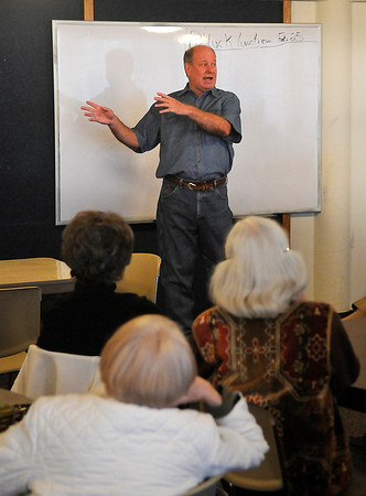 "Dr. Monte Chris McMeans gestures as he talks to the ""Tips From a Veterinarian"" class at the Lifelong Learning Institute of Enid. (Staff Photo by BILLY HEFTON)"