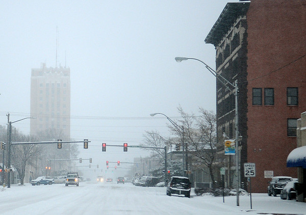 Drivers use caution as they navigate through the fallen snow in downtown Enid Tuesday, Feb. 4, 2014. The second round of winter weather since Sunday dumped 4-8 inches of snow in northwest Oklahoma. (Staff Photo by BONNIE VCULEK)