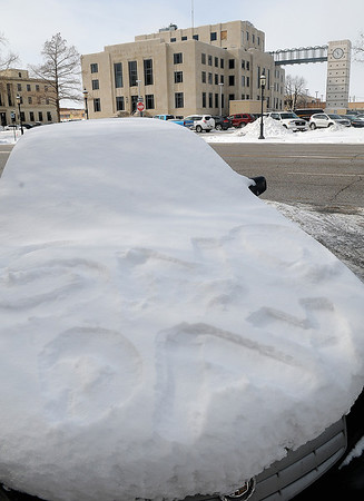 "An Enid High School student's car reads ""SNO DAY"" as snow and ice from Tuesday's winter storm remain in downtown Enid Wednesday, Feb. 5, 2014. Students across Garfield County returned to classes as temperatures reached a low of 5 degrees and wind chills nearing -15. (Staff Photo by BONNIE VCULEK)"