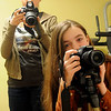 Brianna Merritt (left) and her younger sister Lillian are both budding photographers. Lisa Merritt home schools her two daughters in Enid. (Staff Photo by BONNIE VCULEK)