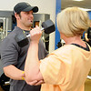 Trevor Chambers, a personal trainer at Finer Physiques, works with Linda Coffin Wednesday, Feb. 12, 2014. (Staff Photo by BONNIE VCULEK)