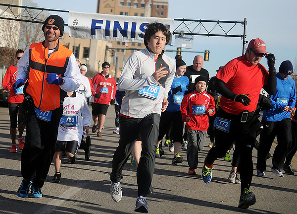 More than 50 runners begin the 5th annual Trot 4 Trykes Saturday, February 15, 2014. Proceeds from the Enid Noon AMBUCS event are used to purchase AmTrykes for children and adults with special needs. (Staff Photo by BONNIE VCULEK)