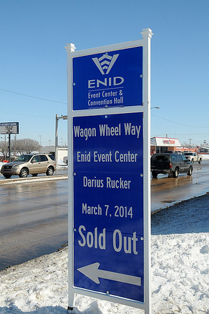 "Traffic passes the new ""Wagon Wheel Way"" sign on Owen K. Garriott Tuesday, Feb. 11, 2014. Global Spectrum and the City of Enid renamed Independence Avenue, between Owen K. Garriott and Maine, in honor of the sold-out Darius Rucker concert on March 7. (Staff Photo by BONNIE VCULEK)"
