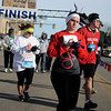 Runners concentrate as they begin the 5th annual Trot 4 Trykes Saturday, Feb. 15, 2014. Proceeds from the Enid Noon AMBUCS event help purchase AmTrykes for children and adults with special needs. (Staff Photo by BONNIE VCULEK)