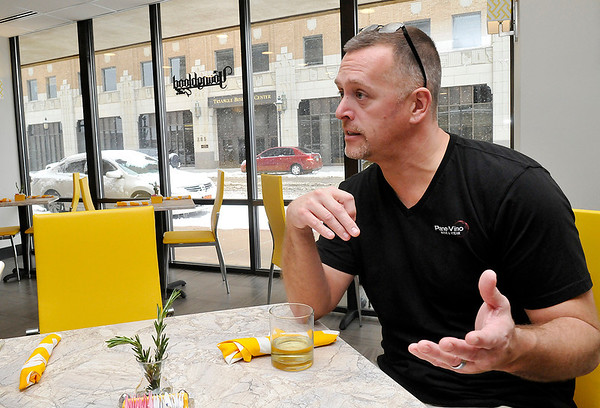 Micky De La Cruz gestures as he talks about the Youngblood Grille, a new lunch restaurant inside Hiland Tower. (Staff Photo by BILLY HEFTON)