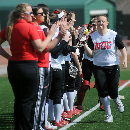 NOC Enid Lady Jets' first baseman Selika Shives high-fives her teammates as she is introduced before the first game at David Allen Memorial Ballpark Friday, Feb. 28, 2014. (Staff Photo by BONNIE VCULEK)