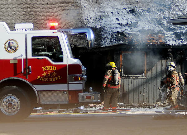 Enid firefighters battle a residential structure fire Saturday, Feb. 22, 2014. (Staff Photo by BONNIE VCULEK)
