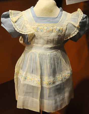 The dress, made by Asfahl of Enid, was purchased for Suzanne Graham Thurman by her grandmother in Fairview, Oklahoma. It is among the items displayed in the new business and technology displays at the Cherokee Strip Regional Heritage Center.  (Staff Photo by BONNIE VCULEK)