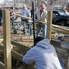 Enid Noon AMBUCS build a handicap ramp for Ron Lewis at 831 E. Pine as part of the organization's National Service Day Saturday, Feb. 22, 2014. (Staff Photo by BONNIE VCULEK)