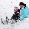 Debbie Brock sleds down the S. Van Buren overpass with her granddaughter Haisley Young Tuesday, Feb. 04, 2014. Area schools were cancelled after a winter storm brought sleet and 4-8 inches of snow to northwest Oklahoma. (Staff Photo by BONNIE VCULEK)