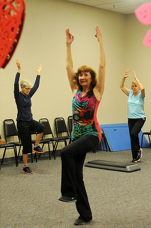 Deb Sexton (center) instructs the senior fitness class at Senior Life Network Friday, Feb. 14, 2014. Sherlene Cameron (back left) and Delores Weingartner (back right) attend the classes regularly. Sexton has been teaching fitness classes for nearly 18 years. (Staff Photo by BONNIE VCULEK)