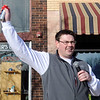Rob Bullis begins the 5th annual Trot 4 Trykes with an air horn Saturday, Feb. 15, 2014. More than 50 runners registered for the Enid Noon AMBUCS event which helps purchase AmTrykes for children and adults with special needs. (Staff Photo by BONNIE VCULEK)