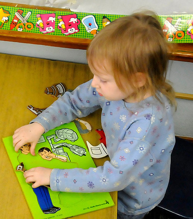 Layla Pendergrift works puzzle February 18 at Carver head start. (Staff Photo by BILLY HEFTON)
