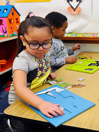 Jessica Garcia and Trevalyn Ware work puzzles February 18 at Carver head start. (Staff Photo by BILLY HEFTON)