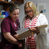 Ashley Iverson (left), an LPN student at Autry Technology Center, and Lynn Brickman, LPN at Enid Community Clinic, review a patient's health history during Nurses Clinic Thursday, Feb. 13, 2014. (Staff Photo by BONNIE VCULEK)