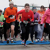 Runners begin the Junior Welfare League Warm Your Heart 5K in downtown Enid Saturday, Feb. 1, 2014. Philip Crum (27) had a time of 20:20, finishing  first in the Male 20-29 age group and second place overall. (Staff Photo by BONNIE VCULEK)