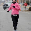 Michelle Klismith, from Enid, finishes the Junior Welfare League Warm Your Heart 5K in 25:15 Saturday, Feb. 01, 2014. (Staff Photo by BONNIE VCULEK)